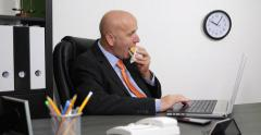 Office Working Program Hungry Sales Manager Eat Breakfast Use Internet Laptop - stock footage