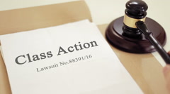 Class action folder with gavel placed on desk of judge in court Stock Footage