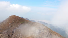 Flowing Clouds in Mountains. 4K Ultra HD 3840x2160 Video Clip Stock Footage
