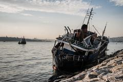 Old Ship Washed Ashore in Bosphorus - stock photo