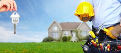 Builder handyman with construction tools. Stock Photos