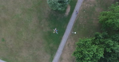 View from above of friends forming a star shape lying in grass - stock footage