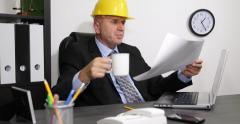 Master Builder Office Job Completing Plans Calculations Engineer Drinking Tea Stock Footage