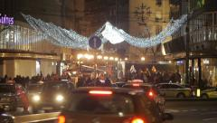 Belgrade streets at Christmas. Urban holiday decoration, traffic and pedestrians Stock Footage