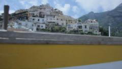 Revealing Buildings Positano from behind Boat Amalfi Coast Italy - 25FPS PAL - stock footage