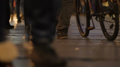 Crowd, walking on Belgrade streets. Night time. Urban scene. Focus on legs - stock footage
