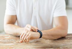 close up of man with heart-rate watch - stock photo