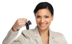 Auto dealer woman with a car key. - stock photo