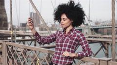 Stock Video Footage of Adult Afro American female taking selfie on brooklyn bridge
