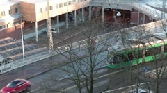 Green streetcar drives near the seaport of the city. Top view, Helsinki, port Stock Footage
