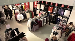 Women clothing department with buyers making purchases is in shopping center Stock Footage