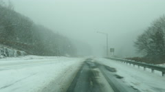 Traffic in heavy zero visibility whiteout blizzard Stock Footage