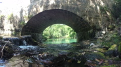 View of Zrmanja river under stone bridge Stock Footage