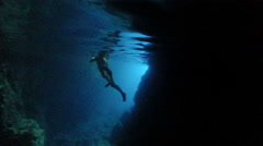 Man swimming in a cave, Bisevo island, Croatia Stock Footage