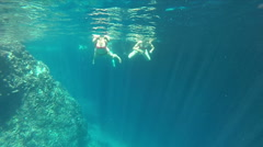 People swimming in cave, underwater shot, Bisevo island, Croatia Stock Footage