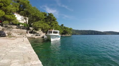 Tour boat docks at pier in Mjlet, Croatia Stock Footage