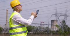Technician Verifying Electrical High Voltage Wires Parameters Energy Industry - stock footage
