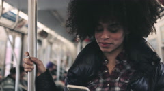 Afro American Female on subway with smart phone - stock footage