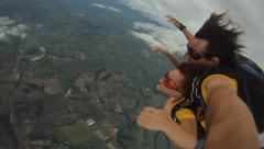 Skydiving tandem jump from the plane Stock Footage