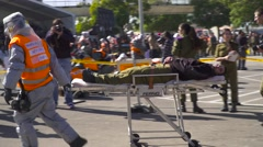 paramedic Treats  wounded soldier - stock footage