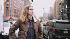 Portrait male standing in street looking to camera, Manhattan New York Stock Footage