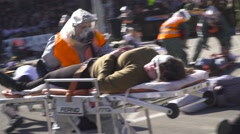paramedic Treats Wounded  Civilians in a chemical Terror  Stock Footage
