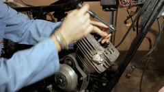 Unscrew the bolts of the cylinder head - stock footage