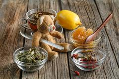 Temperature measurement with toy bear - stock photo