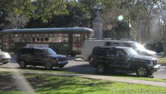 Magic New Orleans:  St. Charles Streetcar passes Audubon Park Stock Footage