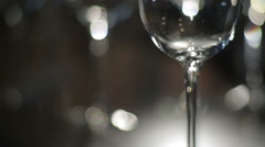 Wine is poured into a glass goblet Stock Footage