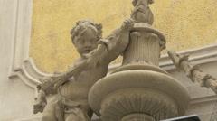 Child sculpture on the facade of Savoyisches Damenstift building in Vienna Stock Footage