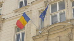 Romanian flag waving on a building in Vienna Stock Footage