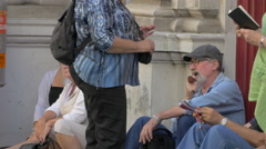 Group of tourists relaxing on a street in Vienna Stock Footage