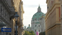 Karlskirche's dome seen from a street in Vienna Stock Footage