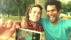 Two young men having fun taking a selfie - stock footage