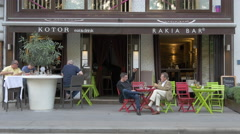 Relaxing at Kotor and Rakia Bar, Vienna Stock Footage