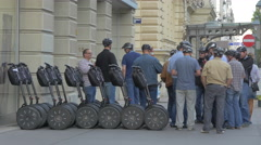 People with helmets standing near segways in Vienna Stock Footage