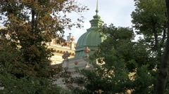 Building with dome seen behind green trees in Vienna Stock Footage