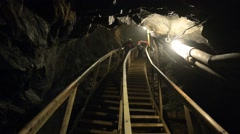 People climb by the stairs in the king's Olav copper mine in Roros, Norway. Stock Footage