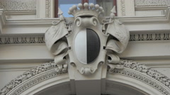 Beautiful coat of arms on a white building in Vienna Stock Footage