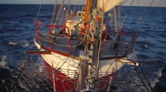 Bowsprit view looking back at dusk on a tall ship in the Canary Islands. Stock Footage