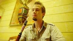 Man smoke waterpipe while looking in camera 4K Stock Footage