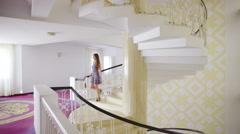 Elegant woman alone walk down stairs  Stock Footage
