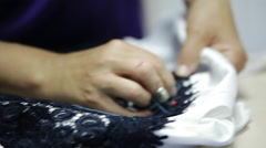 seamstress sews a dress of guipure - stock footage
