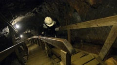 Person climbs up by the stairs in the copper mine in Roros, Norway. Stock Footage
