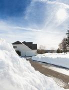 Deep drifts by side of driveway to modern home Stock Photos