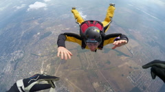 Skydiver in accelerated free fall course - stock footage