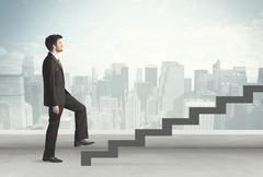 Stock Photo of Business person in front of a staircase
