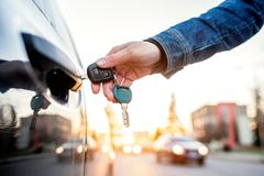 Woman with car key - stock photo