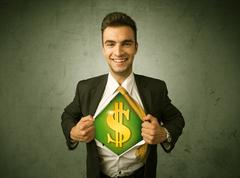 Businessman tearing off his shirt with dollar sign on chest Stock Photos